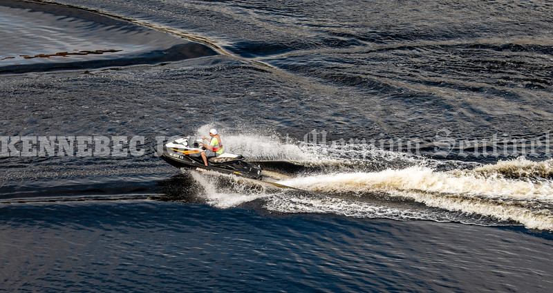 AUGUSTA, ME - SEPTEMBER 18: A personal watercraft rider splashes through the wakes of other people that left East Side Boat Landing ahead of them Saturday September 18, 2021 on the Kennebec River in downtown Augusta. (Staff photo by Joe Phelan/Staff Photographer)