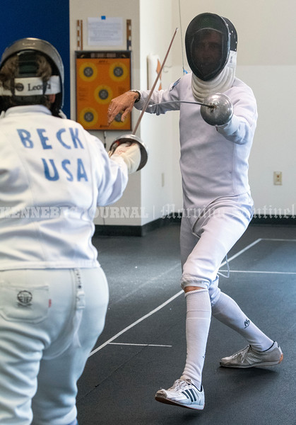 PORTLAND, ME - JULY 16: Sara Beck, (CQ no H) left, and Charles Melcher practice dueling with epees Friday July 16, 2021 at The Portland Fencing Center. (Staff photo by Joe Phelan/Staff Photographer)