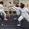 PORTLAND, ME - JULY 16: Fencers on the right practice lunging during a drill Friday July 16, 2021 at The Portland Fencing Center. (Staff photo by Joe Phelan/Staff Photographer)