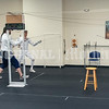 PORTLAND, ME - JULY 16: Head coach Nancy Reynolds, right, leads a foot work drill Friday July 16, 2021 at The Portland Fencing Center. (Staff photo by Joe Phelan/Staff Photographer)