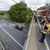 WATERVILLE, MAINE- SEPTEMBER 23, 2021<br /> Shon Dixon, front right, and Tim Beales, back right, both with Delta Ambulance stand above Interstate 95 on Armstrong Road in Waterville on Thursday, Sept. 23, 2021 as a police procession carrying the body of Hancock County Deputy, Luke Gross en route to the State Medical Examiner's office in Augusta. Gross was killed in the early morning hours while responding to a call in Trenton. (Staff Photo by Michael G. Seamans/Staff Photographer)