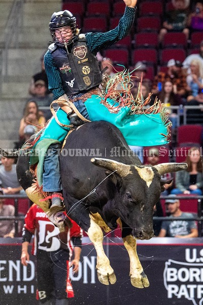 BANGOR, MAINE- JULY 23, 2021<br /> Grayson Cole rides Panic Button during PBR Velocity Tour rodeo competition at the Cross Insurance Center on Friday, July 23, 2021. (Staff Photo by Michael G. Seamans/Staff Photographer)
