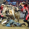 BANGOR, MAINE- JULY 23, 2021<br /> Jose Morales gets tossed to the ground as God's Country stares him down during PBR Velocity Tour rodeo competition at the Cross Insurance Center on Friday, July 23, 2021. (Staff Photo by Michael G. Seamans/Staff Photographer)