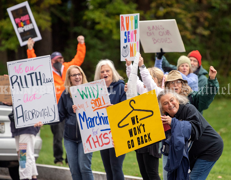 BELGRADE, ME - OCTOBER 2: People wave and cheer as a passing semi truck blows its horns during rally for women's rights Saturday October 2, 2021 in Belgrade Lakes. (Staff photo by Joe Phelan/Staff Photographer)