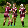 RICHMOND, ME - SEPTEMBER 11: After scoring goal from corner kick, Lila Viselli, center, is congratulated but teammates Sophia Wells, left, and Nicole Tribbet during a soccer game  Saturday September 11, 2021 at Richmond Middle and High School. (Staff photo by Joe Phelan/Staff Photographer)