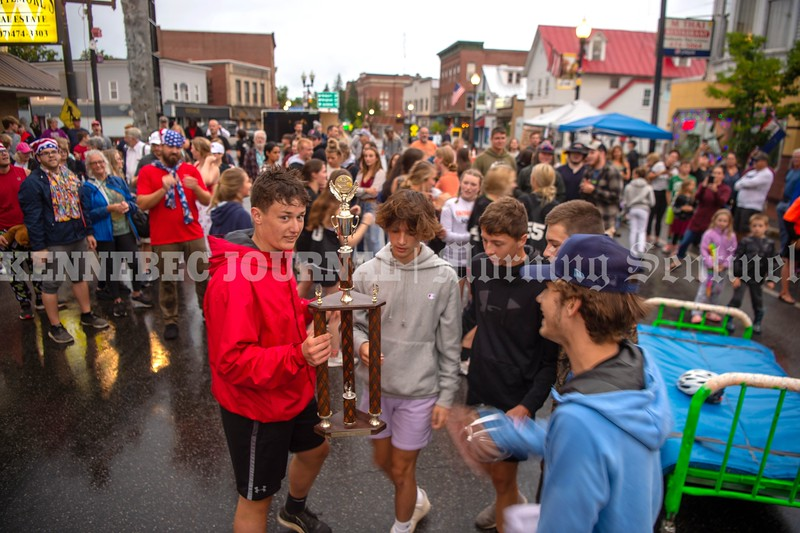 SKOWHEGAN, MAINE- AUGUST 5, 2021<br /> The Skowhegan boys soccer team claims victory in the annual bed races on Water Street in downtown Skowhegan as part of Main Street River Fest on Thursday, August 5, 2021. (Staff Photo by Michael G. Seamans/Staff Photographer)