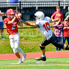 OAKLAND, ME - SEPTEMBER 4: Cony receiver Ashton Dennett hangs on to the ball just caught as Skowhegan defensive back Adam Savage tries to knock it loose Saturday September 4, 2021 in Oakland. (Staff photo by Joe Phelan/Staff Photographer)