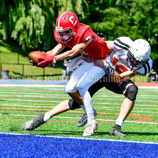 OAKLAND, ME - SEPTEMBER 4: Cony receiver Ashton Dennett reaches out to put the ball into end zone for a touchdown as Skowhegan defensive back Adam Savage drags hime down Saturday September 4, 2021 in Oakland. (Staff photo by Joe Phelan/Staff Photographer)