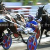 15243# 01fair SKOWHEGAN, MAINE AUGUST 15, 2021. Drivers guide their horses around the track during harness racing at the Skowhegan State Fair in Skowhegan, Maine Sunday August 15, 2021. (Rich Abrahamson/Morning Sentinel)