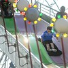 15243# 01fair SKOWHEGAN, MAINE AUGUST 15, 2021. Thrill seekers enjoy the giant slide on the midway at the Skowhegan State Fair in Skowhegan, Maine Sunday August 15, 2021. (Rich Abrahamson/Morning Sentinel)