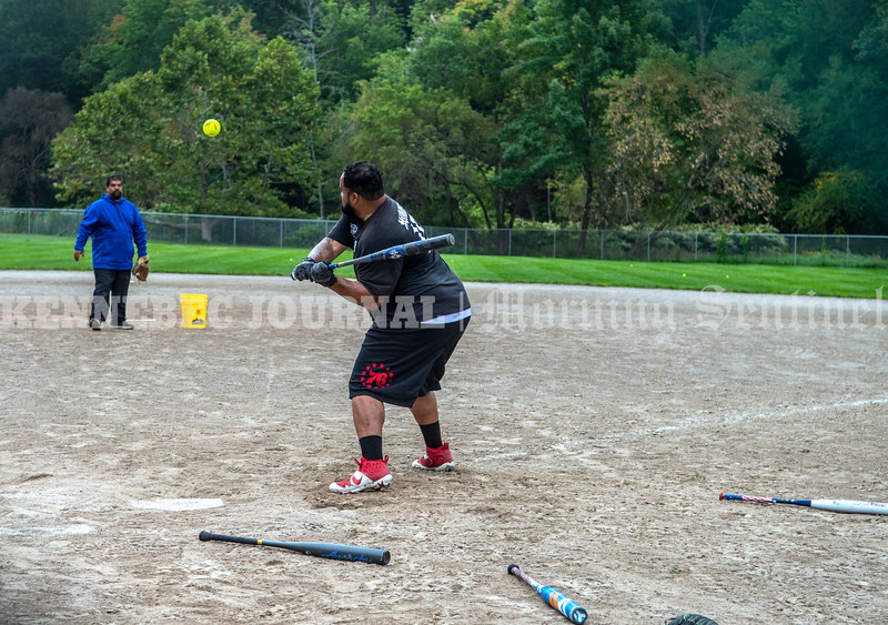 AUGUSTA, ME - SEPTEMBER 15: Kimo Cuares, left, (CQ) left pitches batting practice to Rydell Hayes, right, Wednesday September 15, 2021 at the Newman Brann Memorial Field in Augusta. Hayes said that he was trying to figure which of the bats surrounding him   to use for a tournament the mens' team would be playing in this weekend. (Staff photo by Joe Phelan/Staff Photographer)