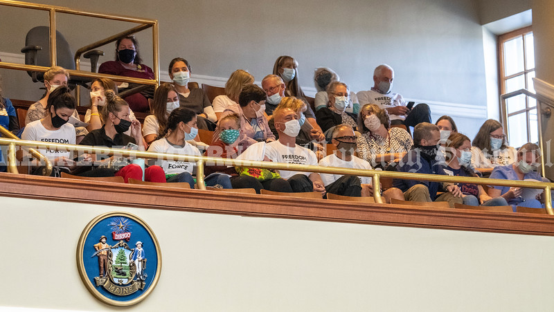 AUGUSTA, ME - SEPTEMBER 29: Members of the Coalition For Health Care Workers Against Medical Mandates sit in the balcony to watch the special legislative session Wednesday September 29, 2021 at the Maine State House in Augusta. (Staff photo by Joe Phelan/Staff Photographer)