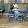 BRUNSWICK, ME - JULY 21: Steve Winter, left, serves as he and teammate Steven Kondor (CQ) play doubles table tennis against Eva Kondor and Chrissy Six (CQ) Wednesday July 21, 2021 at Spectrum Generations in Brunswick. (Staff photo by Joe Phelan/Staff Photographer)