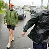 Staff file photo by Joe Phelan<br /> This June 8, 2006 file photo shows Augusta City Manager Bill Bridgeo, right, taking the hand off of the Law Enforcement Torch Run at the Hallowell from Sue Gammon, left, on a rainy Thursday afternoon at the Hallowell line on State Street. The 38th Annual State Special Olympics Summer Games was to be held that weekend at the University of Maine in Orono. Lindsey Graham, center, ran the Gardiner to Hallowell leg with Gammon and Mimi Mattson (not shown).
