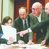 This May 8, 1998 file photo shows Attorney Elizabeth Butler, City Manager Bill Bridgeo, Augusta Mayor John Bridge, and State Planning Office Director Evan Richert reviewing the settlement documents regarding the removal of Edwards Dam from the Kennebec River during a meeting at the Maine State House in Augusta.