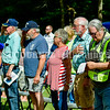 """WINDSOR, ME - SEPTEMBER 11: People salute as Carson Appel (CQ) plays """"Taps"""" to end the dedication ceremony Saturday September 11, 2021 for the new veteran's memorial in Windsor. (Staff photo by Joe Phelan/Staff Photographer)"""
