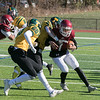 Fitchburg High School football played Tantasqua Regional High School on Saturday, Nov. 16, 2019. TRHS's #4 Ryan Sears tries to take down FHS's #1 Montgomery Graham. Coming in to help is TRHS's #20 Nathan Winco. SENTINEL & ENTERPRISE/JOHN LOVE