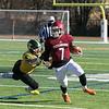 Fitchburg High School football played Tantasqua Regional High School on Saturday, Nov. 16, 2019. TRHS's #4 Ryan Sears tries to take down FHS's #7 Anthony Oquendo. SENTINEL & ENTERPRISE/JOHN LOVE