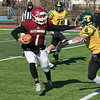 Fitchburg High School football played Tantasqua Regional High School on Saturday, Nov. 16, 2019. FHS's #1 Montgomery Graham tries to avoid TRHS #4 Henry Yang. SENTINEL & ENTERPRISE/JOHN LOVE