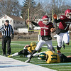 Fitchburg High School football played Tantasqua Regional High School on Saturday, Nov. 16, 2019. FHS's #7 Anthony Oquendo leads the way for his teammate #1 Montgomery Graham as he leaps over TRHS's #11 Casey Robidoux. SENTINEL & ENTERPRISE/JOHN LOVE