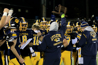 Littleton High School's assistant coach Tim Whitcomb holds up the teams trophy after their win against Blackstone-Millville during the Central Mass. Division 6 championship at Doyle Field in Leominster Saturday, November 10, 2018. SENTINEL & ENTERPRISE/JOHN LOVE