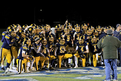 Littleton High School football team poses for a pictures withtheir trophy after their win against  Blackstone-Millville during the Central Mass. Division 6 championship at Doyle Field in Leominster Saturday, November 10, 2018. SENTINEL & ENTERPRISE/JOHN LOVE