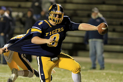 Littleton High School's Mitch Beaudoin reaches for the ends zone as a  Blackstone-Millville's player tries to stop him during the Central Mass. Division 6 championship at Doyle Field in Leominster Saturday, November 10, 2018. SENTINEL & ENTERPRISE/JOHN LOVE