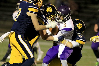 Littleton High School's Evan Lyons, Tucker DeCoste and Kerr Boyle tackle  tries Blackstone-Millville's Alex Luccini during the Central Mass. Division 6 championship at Doyle Field in Leominster Saturday, November 10, 2018. SENTINEL & ENTERPRISE/JOHN LOVE