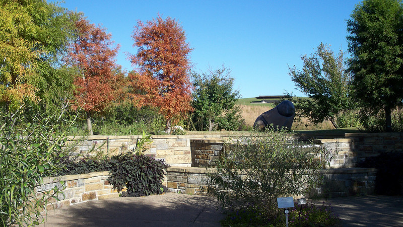 Fall is evident in the Island Gardens area of Powell Gardens.  To the right and in the shadows is the statue of Mhondoro-Great Lion Spirit.  The gardens are east of Kansas City, MO., 20 min. west of Warrensburg, MO.  Oct., 2008