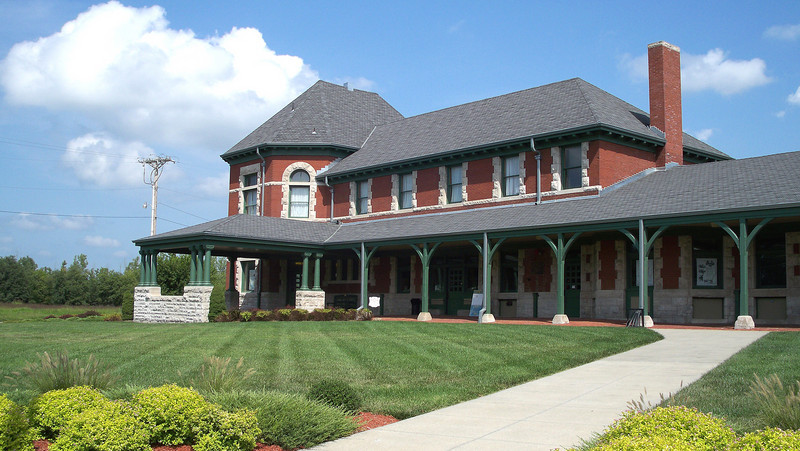 The M K & T railroad depot in Sedalia, Missouri.  Known as the KATY, for short.  The tower to the left was the women's waiting room.  A portico for carriages to pull up and deliver people to the covered walk leading to the front door of the station.  The brick surrounding the building was made at the Coffeyville Brick and Tile Co., Coffeyville, KS.