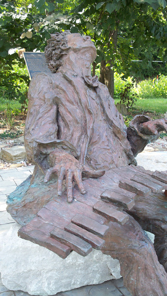 """John William """"Blind"""" Boone (1864-1927) bronze statue created by sculptor Ai Qiu Hopen in 2002.  It sits in Blind Boone Park, Warrensburg, MO. atop a large piece of locally quarried limestone, to honor his accomplishments as a pianist and composer.  Aug., 2008"""