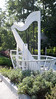 """A wind harp, 13 feet tall, designed by Ron Konzak, played by a 10-15 mph east wind by vibrating the turned metal harp strings.  There is an opening in the back which amplifys the """"music"""".  Blind Boone Park, Warrensburg, MO."""