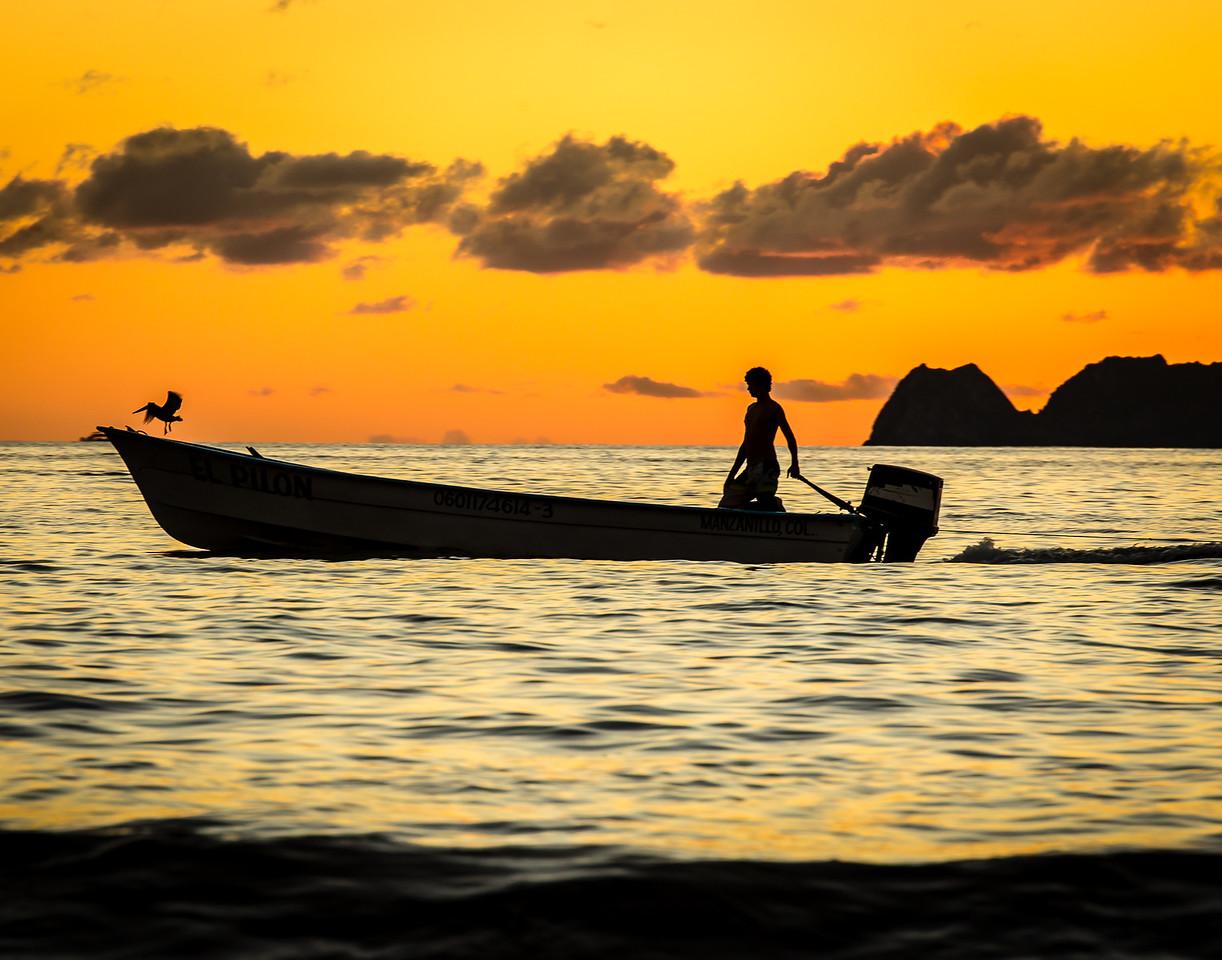 Boy in Boat - Santiago Bay, Mexico