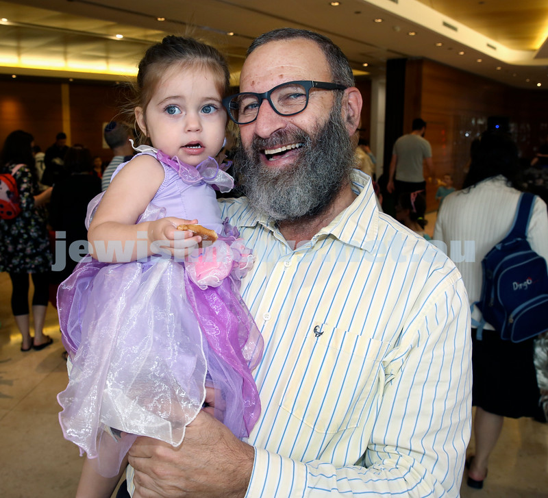 Central Synagogue's Disney themed Purim Party. Louis Goldstein with his grandaughter Mina Clifford. Pic Noel Kessel.