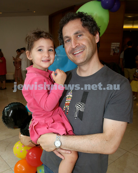 Central Synagogue's Disney themed Purim Party. Andrew Naar with his daughter Tilly. Pic Noel Kessel.