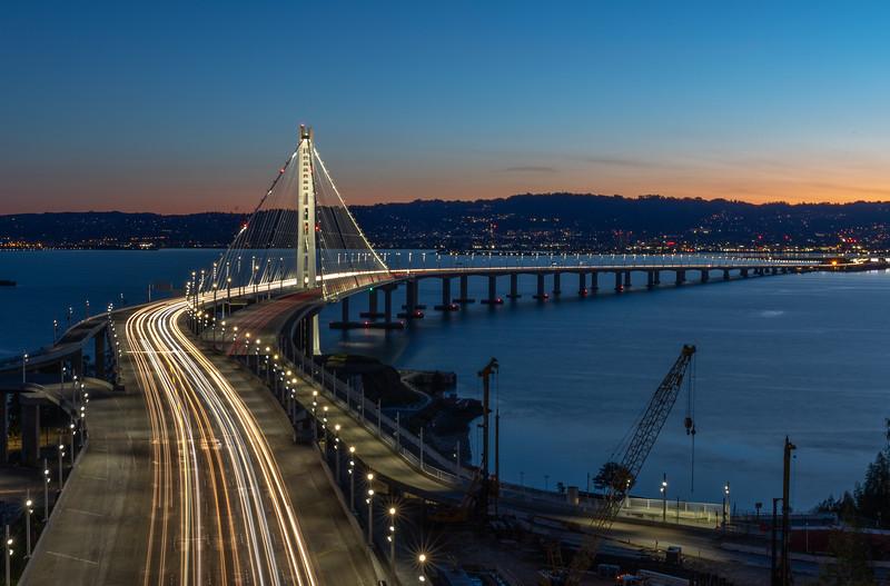 Sunrise behind the eastern span of the bay bridge