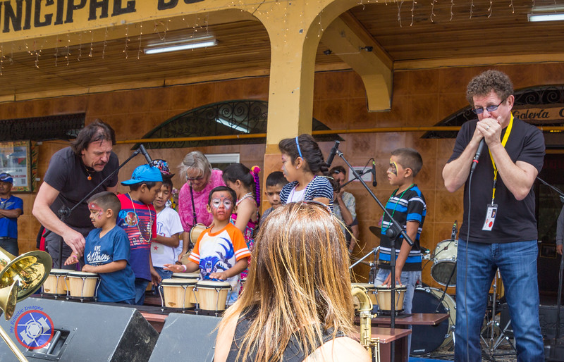 Lee Oscar Accompanying a Group of Children Playing in Public for the First Time After Spending the Morning Learning Basic Musical Skills from some of the Boquete Jazz and Blues Musicians Who Volunteered Their time to Work with the Children (©simon@myeclecticimages.com)