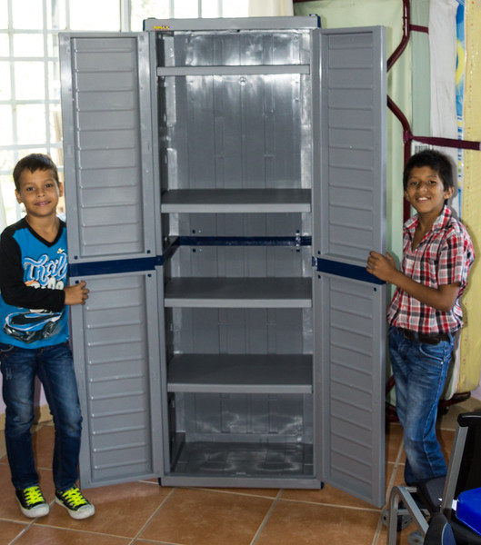 Mariano and Christian Proudly Display a Cabinet They Built with Minimal Adult Supervision (©simon@myeclecticimages.com)