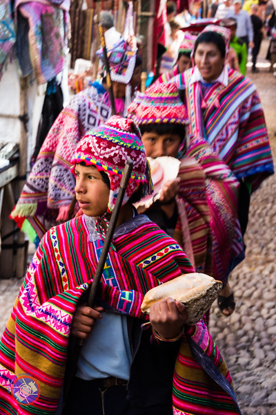 Pisac Men and Youth Parading Through the Market