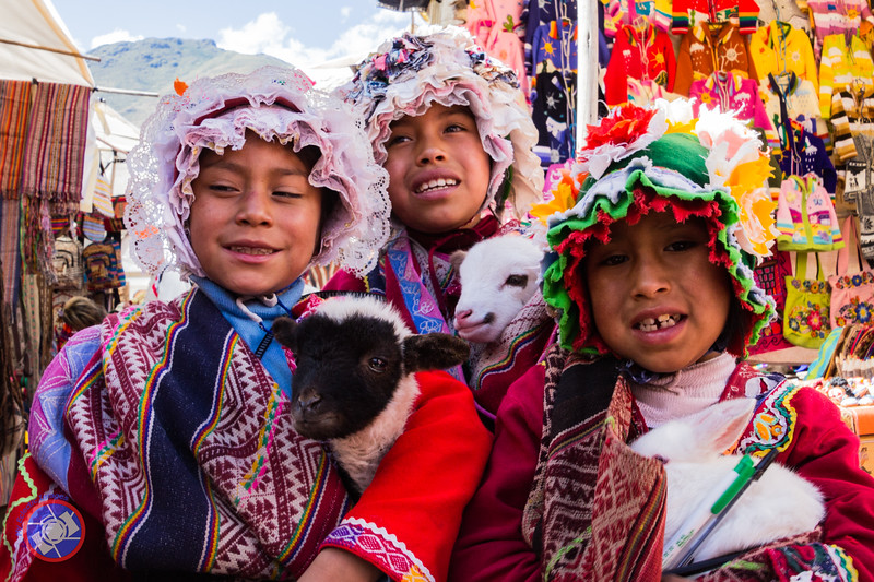 Young Girls in Traditional Costumes Sharing Their Pets