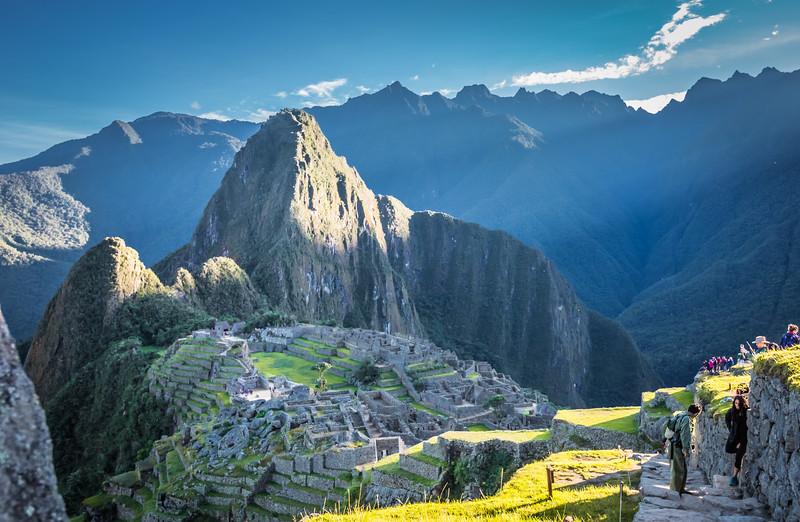 Sunlight illuminating Huayna Picchu Towering oOver the Main Plaza of Machu Picchu