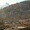 Hills around Kabul. It was from the hills  around Kabul that the city endured merciless shelling from various warring factions in the early 1990s, destroying big sections of the city. Kabul, Afghanistan
