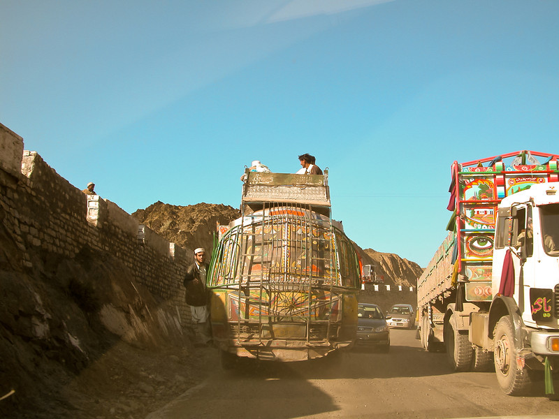 Big garishly painted Pakistani trucks like these often slowed things down in the Khyber Pass. <br /> Taken through the windshield of my taxi.