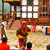 Nobody and nothing is sacred to the Joker at the tsechu. Here he pokes fun at the presiding monks before the dances begin.