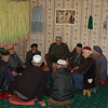 Men gather Friday morning for Naqsbandi Sufi worship ritual.<br /> Sufiism is a type of Muslim religious practice where participants use forms of chanting, dance, singing or meditation to try to understand and feel closer to God. Pankisi is heavily Sufi in religious practice. Pankisi Valley, Georgia