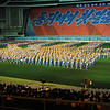 Mass Games: Up to 100,000 performers estimated to take part in them. Note background across stadium. Explanation on next pic. May Day Stadium, Pyongyang, North Korea