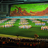 Mass Games: Background made by 20,000 schoolchildren all holding up specially made over-sized books with many designed and colored pages to particular page for each scene. May Day Stadium, Pyongyang, North Korea