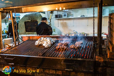 Entire grill moves up and down allowing the certified chefs access to the real wood coals.