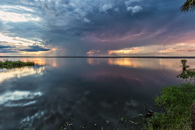 Lightning at sunset over Lake Jesup