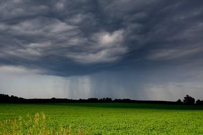 Rainstorm along Hwy 62 by Len Holmes